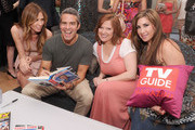 Andy Cohen (second from left) signs copies of his book for Carole Radziwill,Caroline Manzo and Jacqueline Laurita at the TV Guide Magazine & Andy Cohen Book Signing Party on June 21, 2012 in New York City.