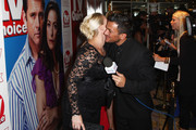 **UK TABLOID NEWSPAPERS OUT**  Peter Andre (R) greets Claire Richards on arriving to attend the TV Quick & TV Choice Awards champagne reception at The Dorchester on September 7, 2009 in London, England.