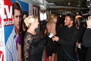 **UK TABLOID NEWSPAPERS OUT** Claire Richards (L) is interviewd by Peter Andre on arriving to attend the TV Quick & TV Choice Awards champagne reception at The Dorchester on September 7, 2009 in London, England.
