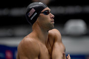 Matt Grevers stretches before the start of the men's 100 meter freestyle preliminary race during the TYR Pro Swim Series at Indiana University Natatorium on May 17, 2018 in Indianapolis, Indiana.