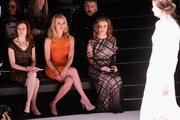 (L-R) Actresses Carrie Preston, Andrea Powell and Alyssa Milano attend Tadashi Shoji fashion show during Mercedes-Benz Fashion Week Fall 2014 at The Salon at Lincoln Center on February 6, 2014 in New York City.