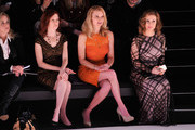 (L-R) Carrie Preston, Andrea Powell and Alyssa Milano attend Tadashi Shoji fashion show during Mercedes-Benz Fashion Week Fall 2014 at The Salon at Lincoln Center on February 6, 2014 in New York City.