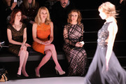 (L-R) Actresses Carrie Preston, Andrea Powell and Alyssa Milano attends Tadashi Shoji fashion show during Mercedes-Benz Fashion Week Fall 2014 at The Salon at Lincoln Center on February 6, 2014 in New York City.