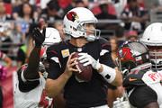 Carson Palmer #3 of the Arizona Cardinals looks to throw the ball while under pressure against the Tampa Bay Buccaneers at University of Phoenix Stadium on October 15, 2017 in Glendale, Arizona.