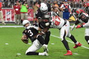 Gerald McCoy #93 of the Tampa Bay Buccaneers fights through a block by Alex Boone #75 of the Arizona Cardinals to sack Carson Palmer #3 during the fourth quarter at University of Phoenix Stadium on October 15, 2017 in Glendale, Arizona.