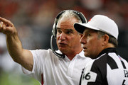 Head coach Mike Smith (L) of the Atlanta Falcons questions a call with referee Walt Anderson #66 during the game against the Tampa Bay Buccaneers at Georgia Dome on November 29, 2009 in Atlanta, Georgia.