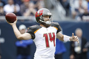 Quarterback Ryan Fitzpatrick #14 of the Tampa Bay Buccaneers looks to pass the football against the Chicago Bears in the first quarter at Soldier Field on September 30, 2018 in Chicago, Illinois.