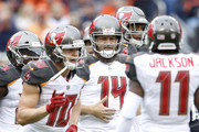 Quarterback Ryan Fitzpatrick #14 of the Tampa Bay Buccaneers stands on the field with teammates in the first quarter against the Chicago Bears at Soldier Field on September 30, 2018 in Chicago, Illinois.