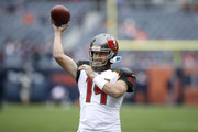 Quarterback Ryan Fitzpatrick #14 of the Tampa Bay Buccaneers warms up prior to the game against the Chicago Bears at Soldier Field on September 30, 2018 in Chicago, Illinois.