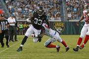 Josh Keyes #50 of the Tampa Bay Buccaneers tackles Chris Ivory #33 of the Jacksonville Jaguars as he runs with the ball during a preseason game on August 20, 2016 at EverBank Field in Jacksonville, Florida. Tampa Bay defeated Jacksonville 27-21.