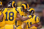 Kenny Britt #18 of the St. Louis Rams congratulates Tavon Austin #11 after Austin scored a touchdown in the first quarter against the Tampa Bay Buccaneers at the Edward Jones Dome on December 17, 2015 in St. Louis, Missouri.