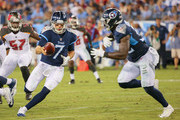 Quarterback Blaine Gabbert #7 of the Tennessee Titans hands off to teammate David Fluellen #32 against the Tampa Bay Buccaneers during the first half of a pre-season game at Nissan Stadium on August 18, 2018 in Nashville, Tennessee.