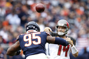 Quarterbck Ryan Fitzpatrick #14 of the Tampa Bay Buccaneers throws a pass against Roy Robertson-Harris #95 of the Chicago Bears in the second quarter at Soldier Field on September 30, 2018 in Chicago, Illinois.