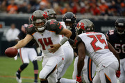Quarterback Ryan Fitzpatrick #14 of the Tampa Bay Buccaneers passes the football off to Peyton Barber #25 in the first quarter at Soldier Field on September 30, 2018 in Chicago, Illinois.