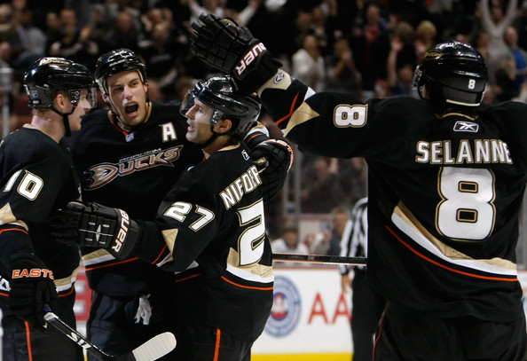 Ryan Getzlaf (L-R) Corey Perry #10, Ryan Getzlaf #15, Scott Niedermayer #27 and Teemu Selanne #8 of the Anaheim Ducks celebrate Niedermayer's game winning goal against the Tampa Bay Lightning at the Honda Center on November 19, 2009 in Anaheim, California. The Ducks defeated the Lightning 4-3 in overtime.