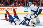 Andrei Markov #79 of the Montreal Canadiens falls over Braydon Coburn #55 of the Tampa Bay Lightning near goaltender Ben Bishop #30 in Game Five of the Eastern Conference Semifinals during the 2015 NHL Stanley Cup Playoffs at the Bell Centre on May 9, 2015 in Montreal, Quebec, Canada. The Canadiens defeated the Lightning 2-1.  The Lightning lead the series 3-2.