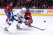 Ondrej Palat #18 of the Tampa Bay Lightning and P.K. Subban #76 of the Montreal Canadiens chase the puck during the NHL game at the Bell Centre on March 10, 2015 in Montreal, Quebec, Canada.