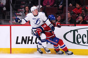 P.K. Subban #76 of the Montreal Canadiens and Ondrej Palat #18 of the Tampa Bay Lightning battle for position during the NHL game at the Bell Centre on March 10, 2015 in Montreal, Quebec, Canada.