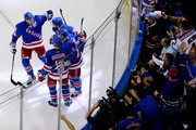 Derek Stepan #21 of the New York Rangers celebrates with teammates after scoring a goal in the second period against the Tampa Bay Lightning in Game One of the Eastern Conference Finals during the 2015 NHL Stanley Cup Playoffs at Madison Square Garden on May 16, 2015 in New York City.