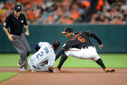 Denard Span #2 of the Tampa Bay Rays slides into second base with a double ahead of the tag of Jonathan Schoop #6 of the Baltimore Orioles in the seventh inning at Oriole Park at Camden Yards on May 11, 2018 in Baltimore, Maryland.