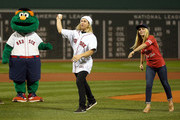 Olympic gold medalist Sage Kotsenburg and World Snowboarder Ty Walker throw out the first pitch during a ceremony before a game with the Tampa Bay Rays at Fenway Park on September 22, 2015 in Boston, Massachusetts.