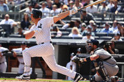 Matt Holliday #17 of the New York Yankees hits a single against the Tampa Bay Rays in the first inning during the New York Yankees home Opening game at Yankee Stadium on April 10, 2017 in New York City.