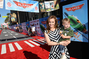 """Actress Alyssa Milano and son Milo Bugliari attend the world-premiere of """"Disney's Planes"""" presented by Target at the El Capitan Theatre on August 5, 2013 in Hollywood, California."""