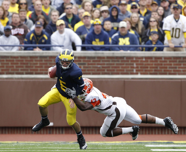 Bowling Green v Michigan [player,sports,tournament,sport venue,sports equipment,ball game,sports gear,gridiron football,canadian football,team sport,tate forcier 5,eugene fells,gain,michigan,stop,ann arbor,michigan stadium,bowling green,michigan wolverines]