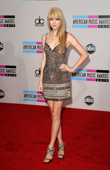 Taylor Swift Musician Taylor Swift arrives at the 2010 American Music Awards held at Nokia Theatre L.A. Live on November 21, 2010 in Los Angeles, California.