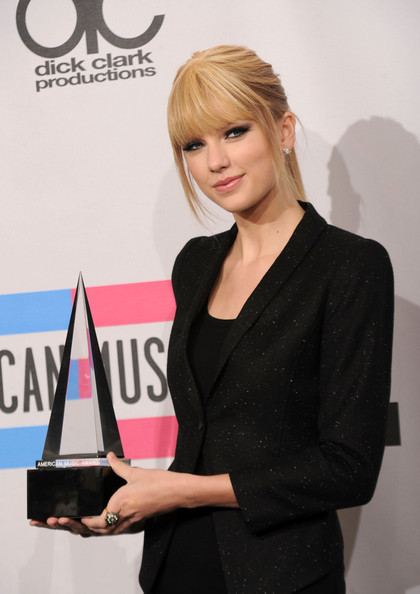 Taylor Swift Musician Taylor Swift, winner of the Country Music - Favorite Female Artist award, poses in the press room during the 2010 American Music Awards held at Nokia Theatre L.A. Live on November 21, 2010 in Los Angeles, California.