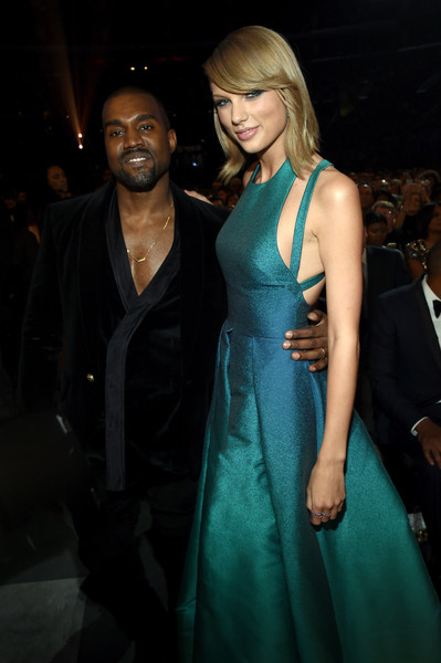 The 57th Annual GRAMMY Awards - Backstage [formal wear,fashion model,beauty,fashion,flooring,hairstyle,dress,carpet,girl,outerwear,audience,taylor swift,california,los angeles,staples center,recording artists kanye west,57th annual grammy awards,the 57th annual grammy awards]