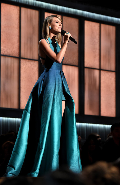 57th Annual Grammy Awards Show [taylor swift,gown,dress,performance,beauty,fashion,formal wear,lady,fashion model,event,performing arts,57th annual grammy awards,california,los angeles,staples center]