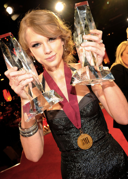 Taylor Swift Taylor Swift with awards for BMI Songwriter of the Year and Co Writer of BMI Song of the Year at the 58th Annual BMI Country Music Awards at BMI on November 9, 2010 in Nashville, Tennessee.