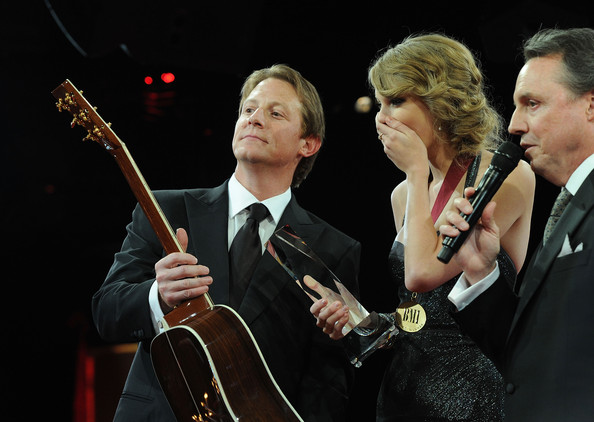 Taylor Swift BMI, Asst. VP, Writer/Publisher Relations, Nashville, Clay Bradley and BMI VP, Writer/Publisher Relations, Nashville, Jody Williams present a Martin Guitar to Taylor Swift winner of awards for BMI Songwriter of the Year and Co Writer of BMI Song of the Year at the 58th Annual BMI Country Music Awards at BMI on November 9, 2010 in Nashville, Tennessee.