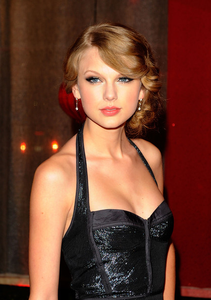 Taylor Swift Taylor Swift attends the 58th Annual BMI Country Music Awards at BMI on November 9, 2010 in Nashville, Tennessee.