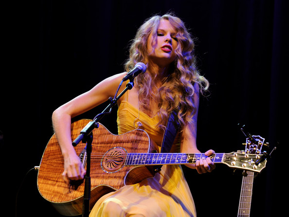 "Taylor Swift Singer/songwriter Taylor Swift performs at the Country Music Hall of Fame & Museum's ""All For The Hall"" at Club Nokia on September 23, 2010 in Los Angeles, California."