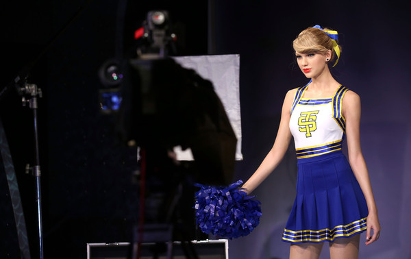 Madame Tussauds Unveil Taylor Swift Wax Figure [madame tussauds,taylor swift,wax figure,wax figure,clothing,fashion,fashion design,uniform,sports uniform,performance,cheerleading,electric blue,fashion model,dancer,london,england]