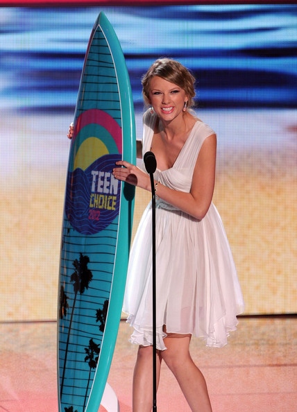 Taylor Swift Singer Taylor Swift accepts the Choice Female Artist award onstage during the 2012 Teen Choice Awards at Gibson Amphitheatre on July 22, 2012 in Universal City, California.