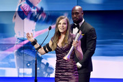 Oksana Masters accepts the Female Paralympic Athlete of the Games from Vernon Davis during the Team USA Awards at the Duke Ellington School of the Arts on April 26, 2018 in Washington, DC.