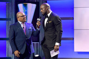 Mike Tirico and Vernon Davis speak onstage during the Team USA Awards at the Duke Ellington School of the Arts on April 26, 2018 in Washington, DC.