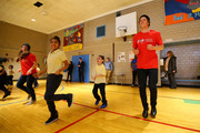 Olympic hopefull Joss Christensen stretches with students from P.S. 133  Fred R. Moore Academy on Febuary 8, 2017 in New York City. Team USA celebrates the one-year countdown to the Olympic Winter Games PyeongChang 2018.