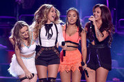 (L-R) Singers Perrie Edwards, Jade Thirlwall, Leigh-Anne Pinnock and Jesy Nelson of Little Mix accept the Choice Music Group: Female onstage during the Teen Choice Awards 2015 at the USC Galen Center on August 16, 2015 in Los Angeles, California.