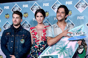 (L-R) Actors Cody Christian, Shelley Hennig and Tyler Posey pose with the Choice Summer TV Show award for 'Teen Wolf'  in the press room during Teen Choice Awards 2016 at The Forum on July 31, 2016 in Inglewood, California.