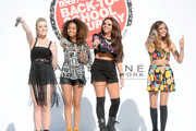 (L-R) Perrie Edwards, Leigh-Anne Pinnock, Jesy Nelson, and Jade Thirlwall of Little Mix perform onstage at Teen Vogue's Back-to-School Saturday kick-off event at The Grove on August 9, 2013 in Los Angeles, California.