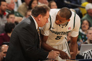 Head coach Tom Izzo of the Michigan State Spartans gives instructions to Adreian Payne #5 as the Spartans take on the Wisconsin Badgers during their Semifinal game of the 2012 Big Ten Men's Basketball Conference Tournament at Bankers Life Fieldhouse on March 10, 2012 in Indianapolis, Indiana. Michigan State defeated Wisconsin 65-52.