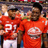 Montee Ball Photos - Montee Ball #28 of the Wisconsin Badgers celebrates a 70-31 win over the Nebraska Cornhuskers with Peniel Jean #21after the Big 10 Conference Championship Game at Lucas Oil Stadium on December 1, 2012 in Indianapolis, Indiana. - Big Ten Championship - Nebraska v Wisconsin