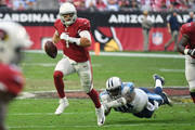Blaine Gabbert #7 of the Arizona Cardinals scrambles to make a pass against Jurrell Casey #99 of the Tennessee Titans in the second half at University of Phoenix Stadium on December 10, 2017 in Glendale, Arizona.