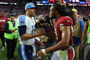 Matt Cassel #16 of the Tennessee Titans and Larry Fitzgerald #11 of the Arizona Cardinals shake hands after the NFL game at University of Phoenix Stadium on December 10, 2017 in Glendale, Arizona. The Arizona Cardinals won 12 - 7.