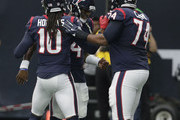 Deshaun Watson #4, DeAndre Hopkins #10 and Chris Clark #74 of the Houston Texans celebrate a touchdown against the Tennessee Titans in the first quarter at NRG Stadium on October 1, 2017 in Houston, Texas.