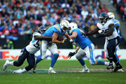 Philip Rivers #17 of the Los Angeles Chargers is sacked by Jayon Brown #55 of the Tennessee Titans during the NFL International Series game between Tennessee Titans and Los Angeles Chargers at Wembley Stadium on October 21, 2018 in London, England.
